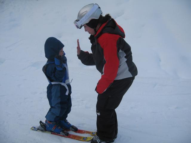 Hi five Kohu (after skiing down the Magic Carpet